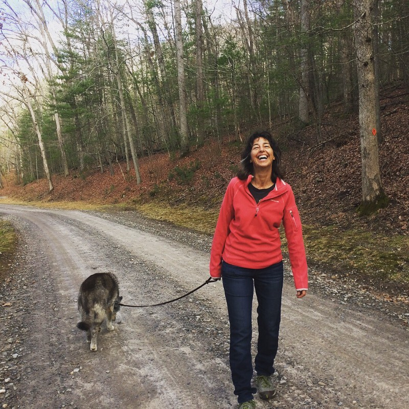 creative woman walking dog