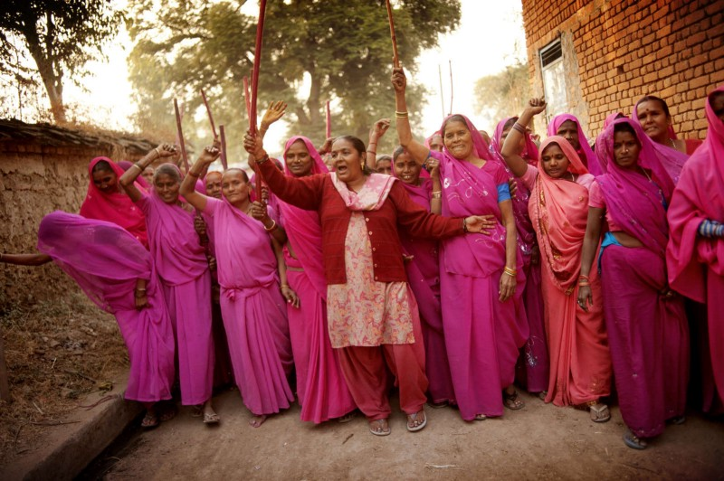 "Members of the gang walk around the village, proclaiming the presense of Gulabi Gang. The Gulabi gang, or ""the pink gang"" (a direct translation from Hindi), is a group of women who have decided to take justice into their own hands."
