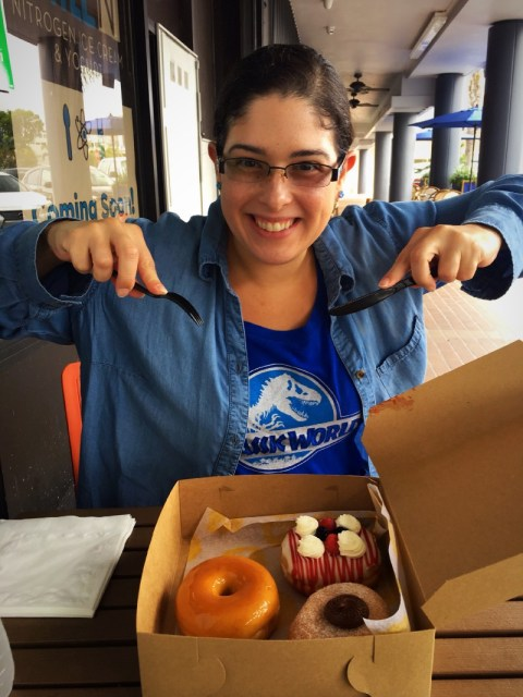 Picture me holding a plastic fork and knife over a box with three of the most delicious doughnuts you've ever seen inside the box.