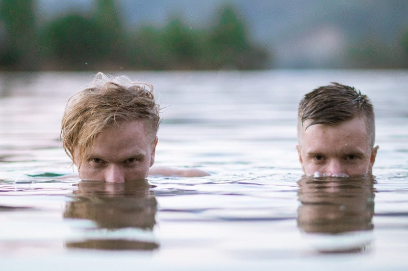 Two men on the body of water during daytime.