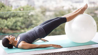 woman-stretching-legs-on-fitness-ball