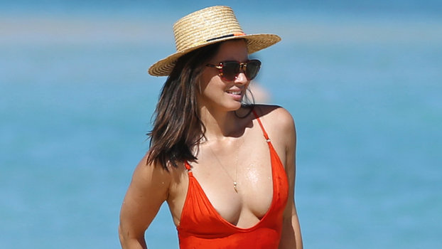 Olivia Munn Wears A Red Hot Swimsuit In December