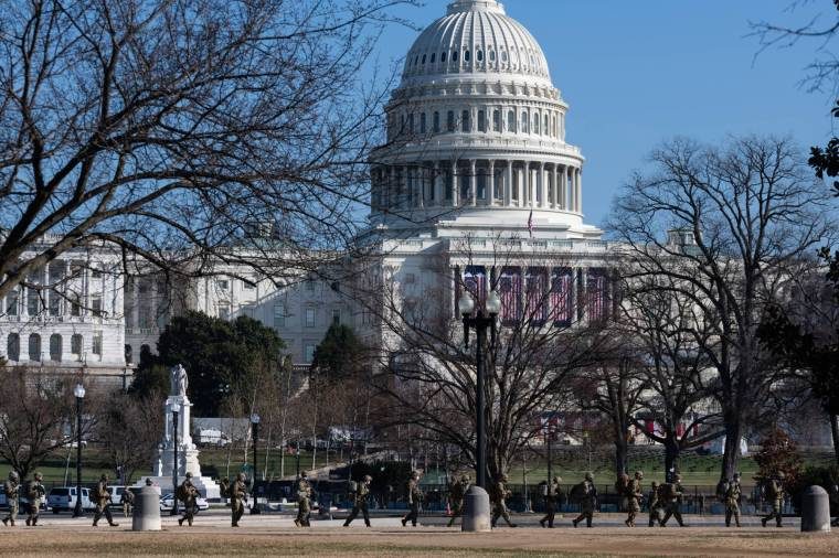 Members of the National Guard march in front of the US Capitol Building in Washington on Wednesday.  |  Bloomberg