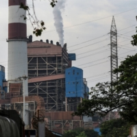 Smoke rises from a chimney at a thermal power station in Mumbai. | BLOOMBERG