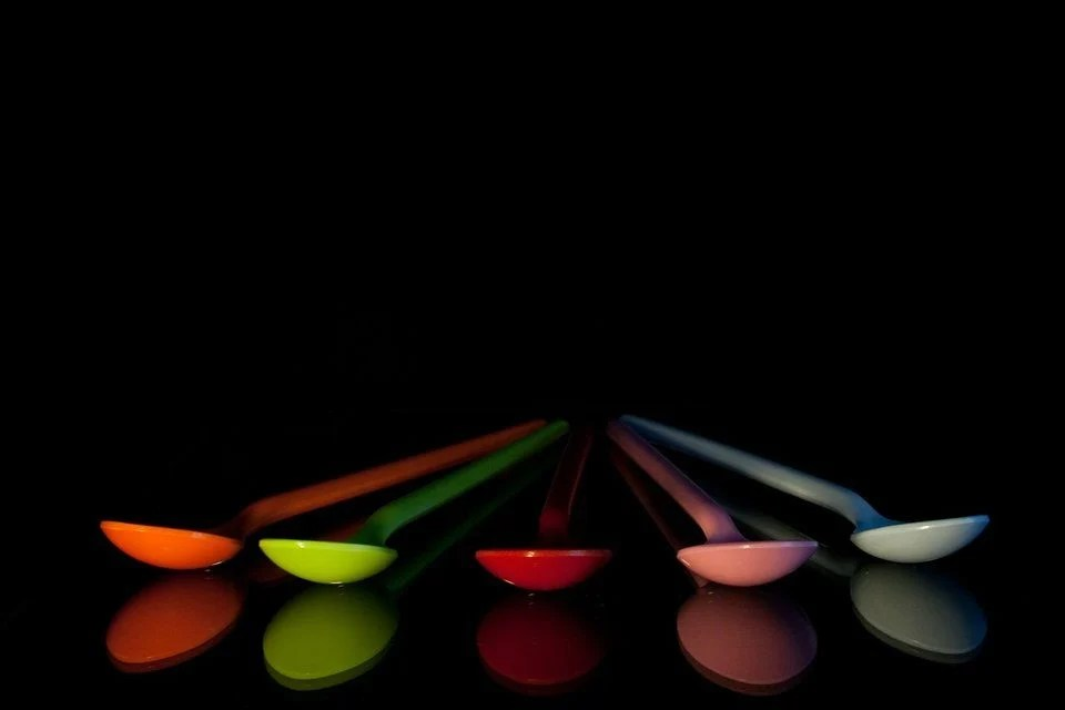 picture of colorful blue plastic spoons