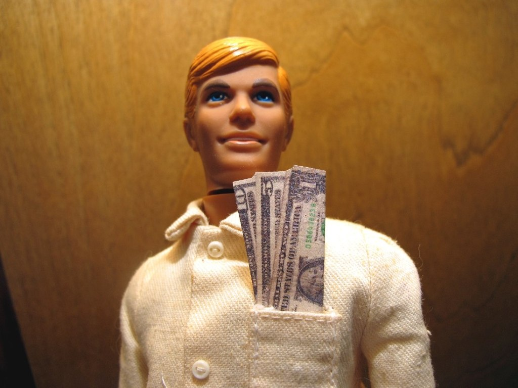 Ken doll with money in his pocket