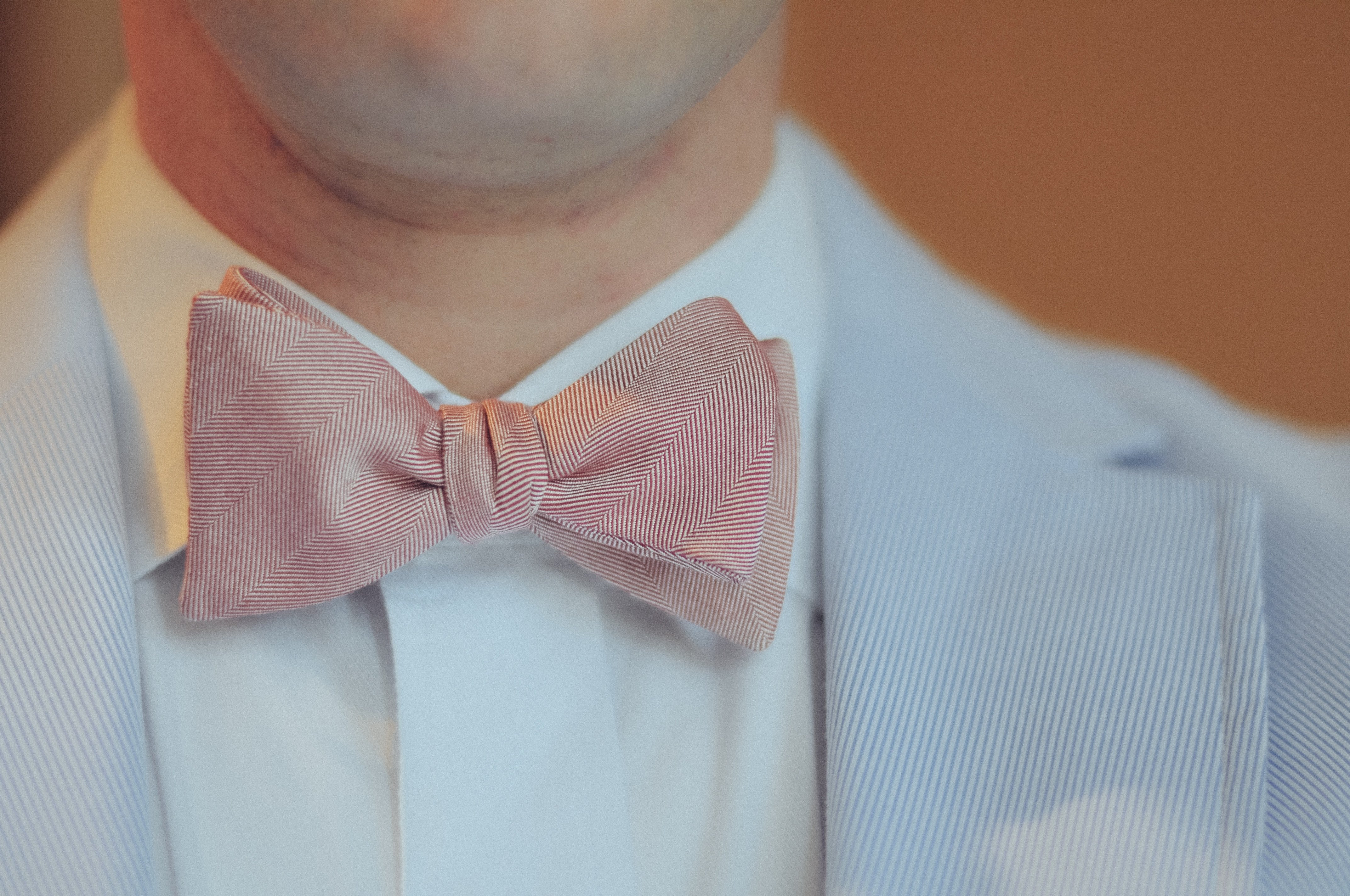 Self Tied Pink Bowtie On Man With Blue Jacket