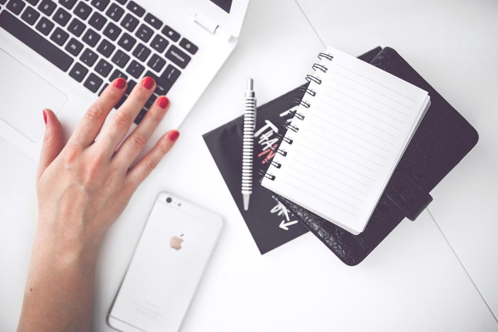 Woman Hand Smartphone Desk