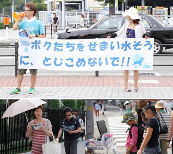 ativistas-rua-olhando-aquario-japão-crianças-golfinhos