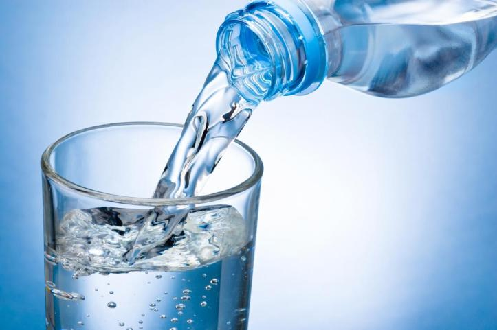 Glass of water being poured which is a home remedy for upset stomach