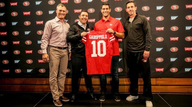 (From left to right) General manager John Lynch, CEO Jed York, Jimmy Garoppolo and coach Kyle Shanahan celebrate the quarterback's arrival in San Francisco on Tuesday.