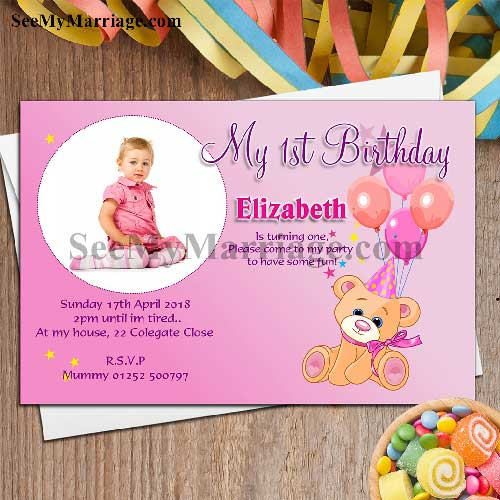 twinkle sun shine pink color teddy theme birthday invite card with balloons and candies in wood background