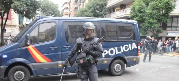 Agente antidisturbios en Barcelona