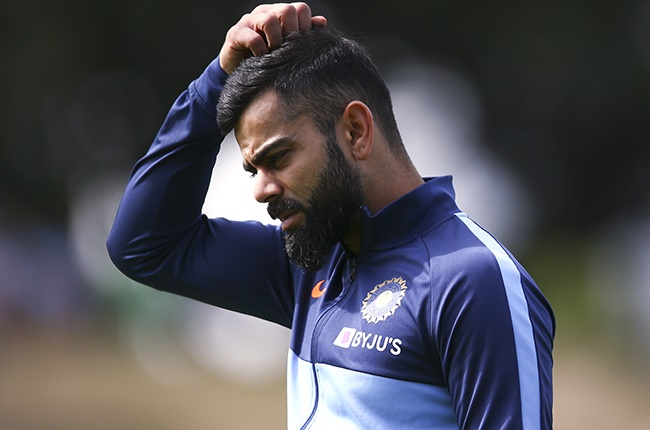 india coronavirus Virat Kohli looks on during day two of the first Test between New Zealand and India at Basin Reserve on 22 February 2020 in Wellington.