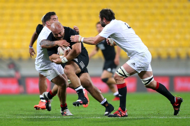Karl Tuinukuafe of North is tackled by Codie Taylor and Samuel Whitelock of South during the North v South rugby match at Sky Stadium on September 05, 2020 in Wellington, New Zealand. (Photo by Hagen Hopkins/Getty Images)