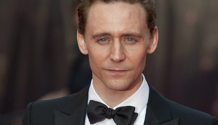 British actor Tom Hiddleston arrives for the Oliver Awards at the Royal Opera House in London (Reuters)