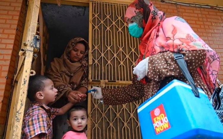 Polio worker on a door-to-door vaccination drive in Pakistan