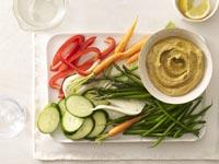 Hummus with raw vegetable batons.