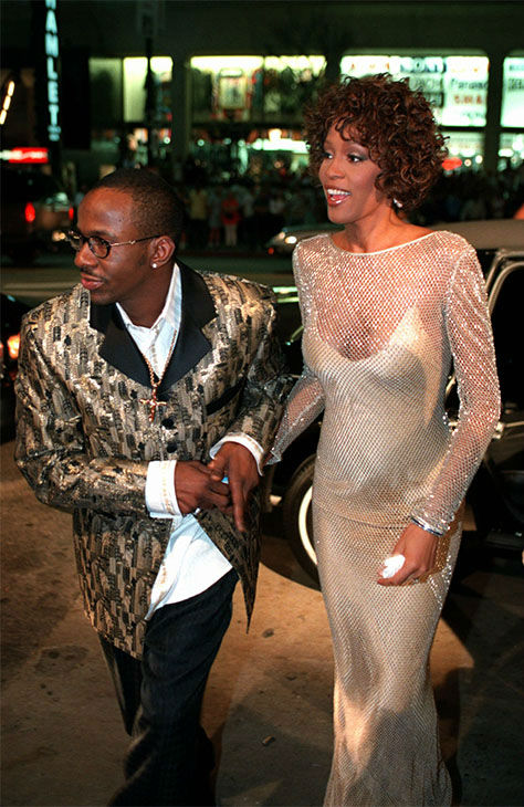 "Oct. 1997: Houston with husband Bobby Brown at the premiere of ""The Wonderful World of Disney"" movie ""Cinderella."" Houston served as Exec Producer and played the fairy godmother. <span class=meta>Photo/AP Photo</span>"