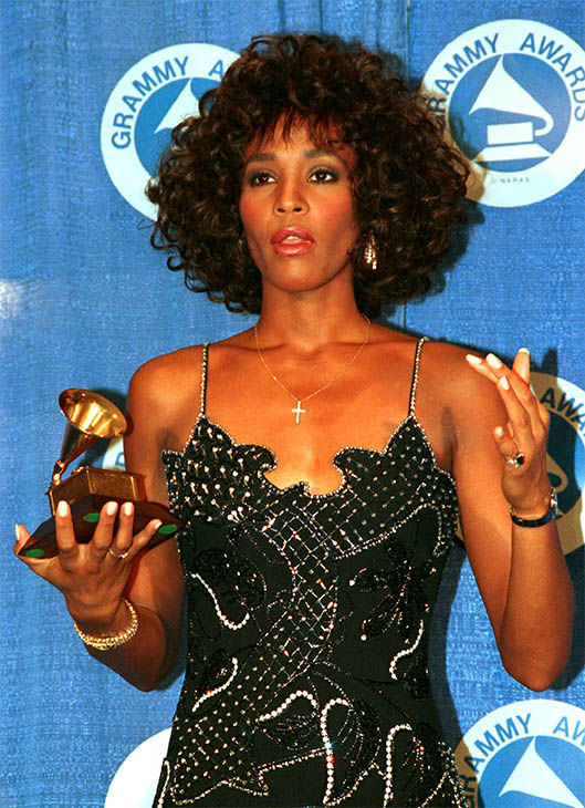 "Mar. 1988: poses with her Grammy at the annual Grammy Awards presentation after winning best female vocalist for her single ""I Wanna Dance with Somebody."" <span class=meta>Photo/AP Photo</span>"