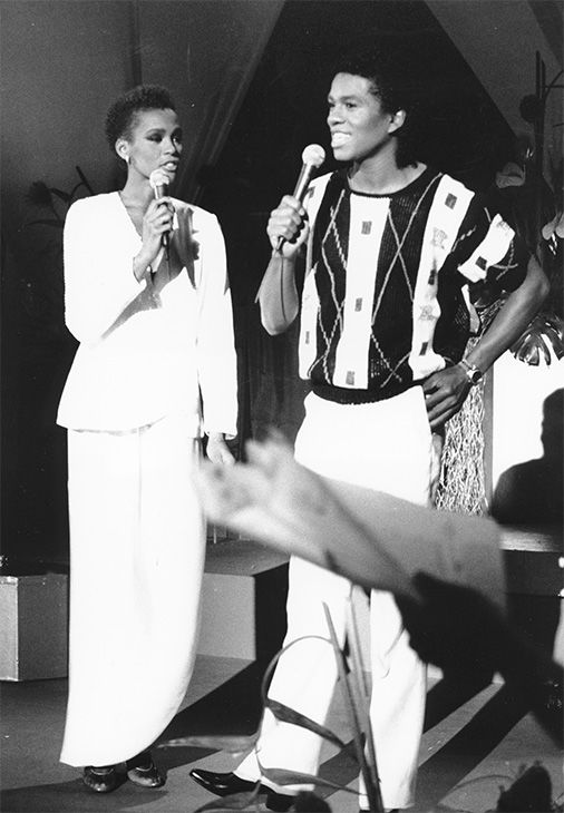 "July 1984: Houston, left, and Jermaine Jackson sing during a rehearsal for the CBS television soap opera ""As the World Turns"" in New York. <span class=meta>Photo/AP Photo</span>"