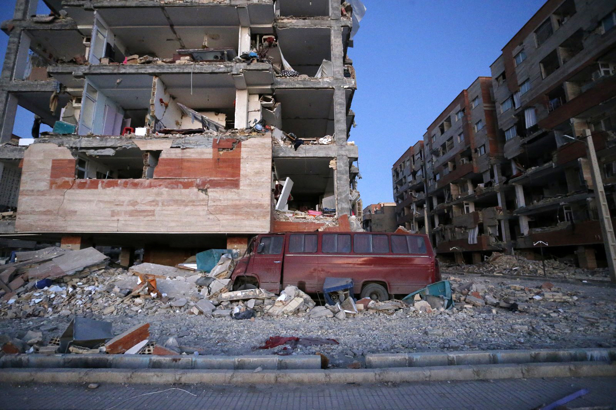 <div class='meta'><div class='origin-logo' data-origin='none'></div><span class='caption-text' data-credit='Pouria Pakizeh/ISNA via AP'>In this photo provided by the ISNA, destroyed buildings and a car are seen after an earthquake at the city of Sarpol-e-Zahab in western Iran, Monday, Nov. 13, 2017.</span></div>