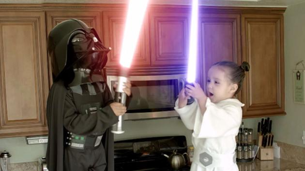 Two adorable toddlers dressed as Darth Vader and Princess Leia engage in a fierce lightsaber battle over a cupcake. Click through to find out who wins. <span class=meta>Oscar Rene/YouTube</span>