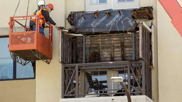 <div class='meta'><div class='origin-logo' data-origin='none'></div><span class='caption-text' data-credit='AP Photo/Noah Berger'>Workers examine a balcony that collapsed in Berkeley, Calif., Tuesday, June 16, 2015.</span></div>