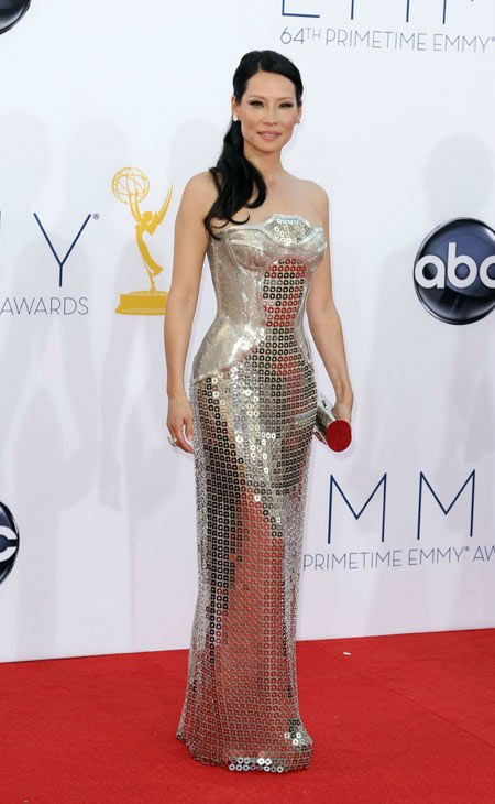 Lucy Liu arrives at the 64th Primetime Emmy Awards at the Nokia Theatre on Sunday, Sept. 23, 2012, in Los Angeles.