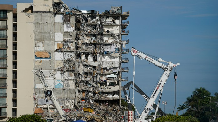 Threats of another collapse, storm challenge Miami-area condo search and rescue