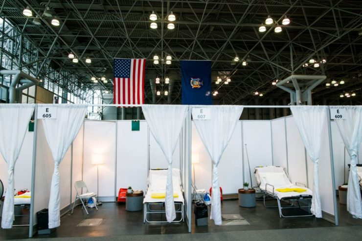 Hospital bed booths are set up at the Javits Center, which is being turned into a temporary hospital to help fight COVID-19 cases, in New York City on March 27, 2020.