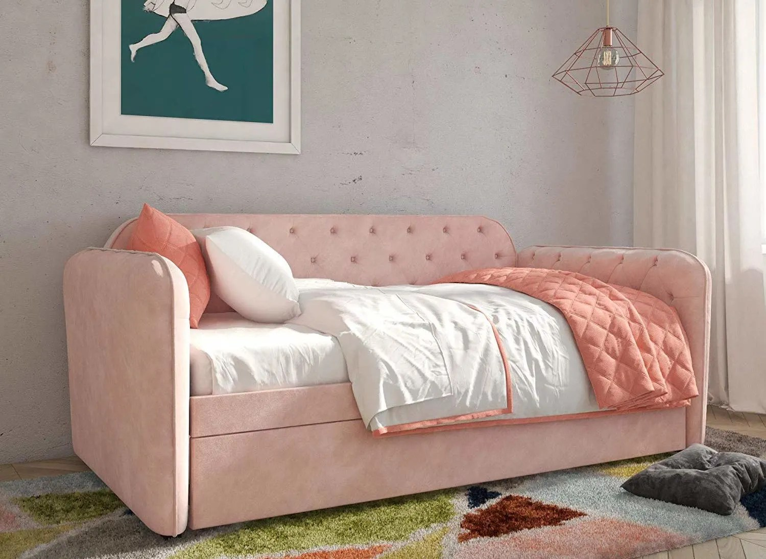 Decorating a small home might seem like a bit of a challenge at first. This Pink Velvet Daybed Is Also a Trundle Bed | Apartment