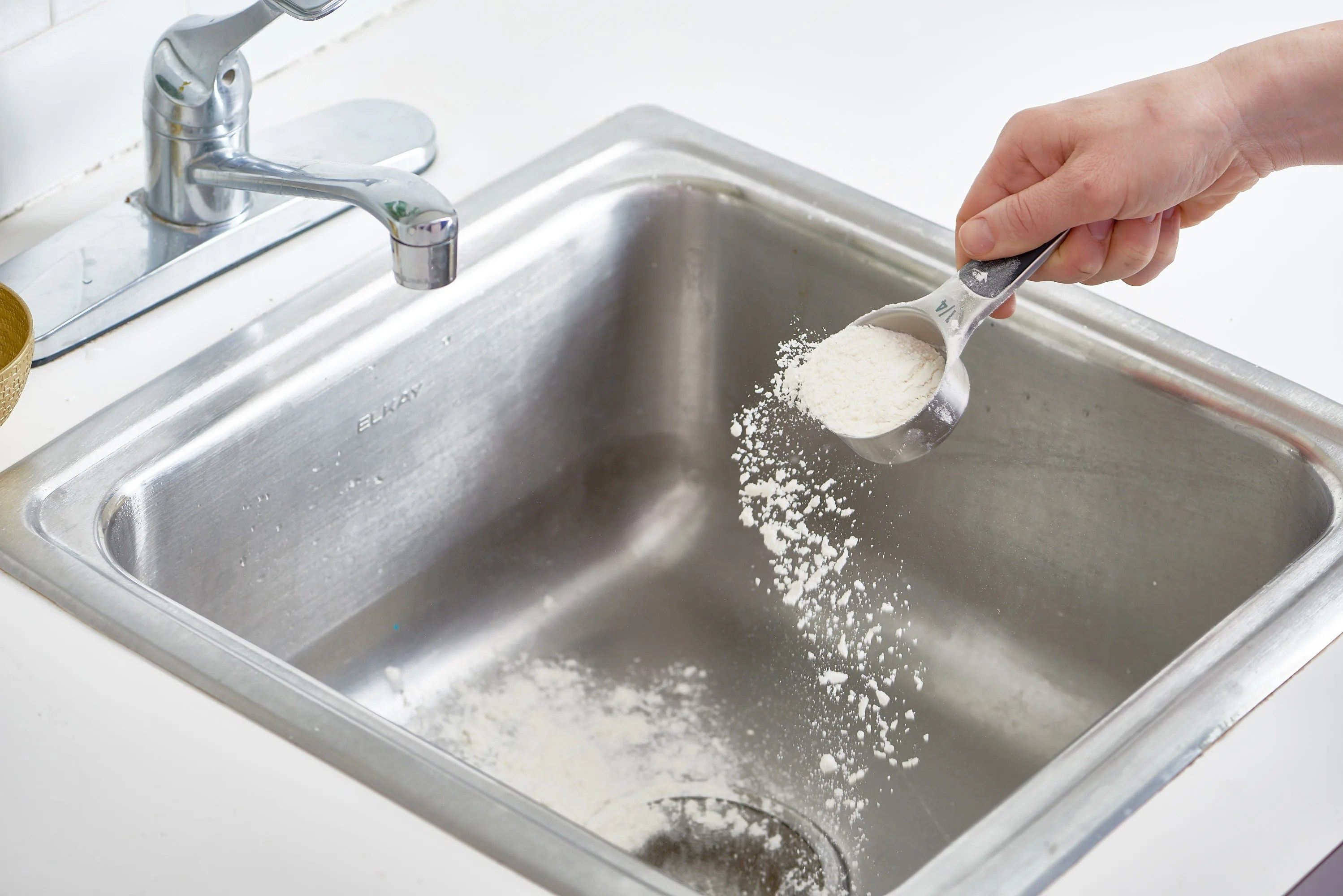 a stainless steel sink with flour