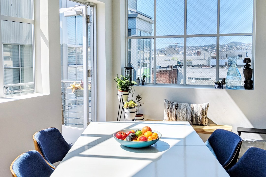 A Bright, Minimal-ish San Francisco Condo Has a Cute, Plant-Filled Modern Balcony