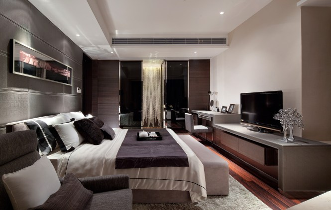 A Beautiful Master Bedroom With Unique Textures