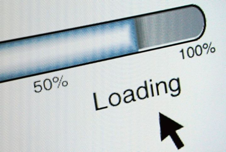 A computer showing a slow-moving loading bar.