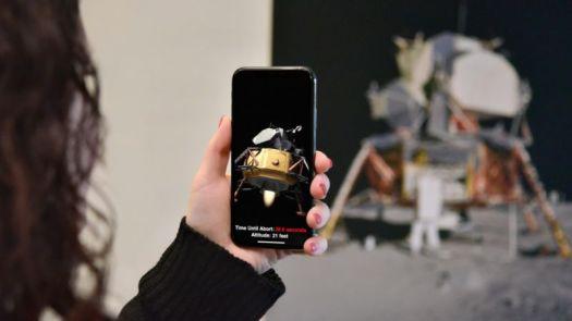 A woman uses a smartphone to take a photo.