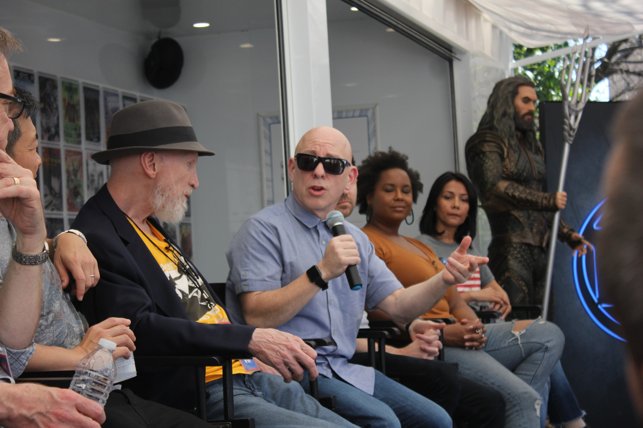 Brian Michael Bendis, seated with Frank Miller to his right and writers Nadria Tucker and Lina Patel to his left.