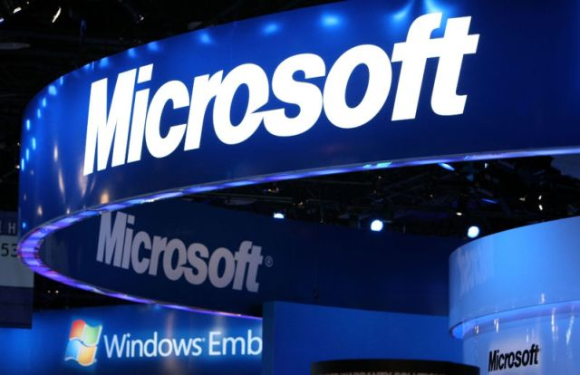 The Microsoft logo displayed at Microsoft's booth at a trade show.