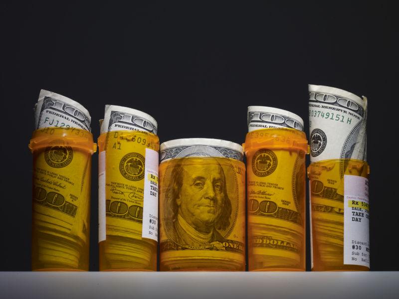 Hundred dollar bills inside prescription pill bottles