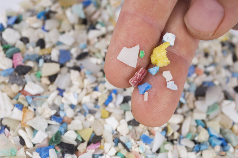 Microplastics come from tiny plastic pieces in products like microbeads, as well as broken-down pieces of larger plastics.