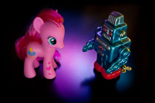 A toy robot confronts a My Little Pony.