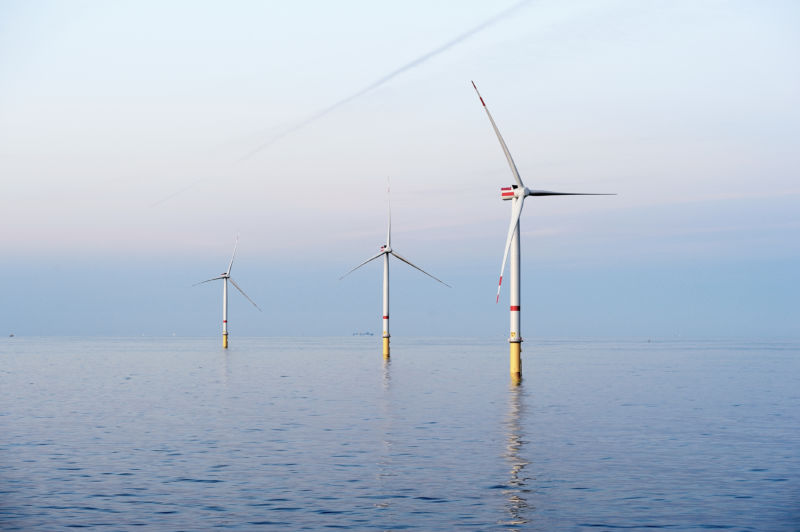 Several offshore wind turbines.