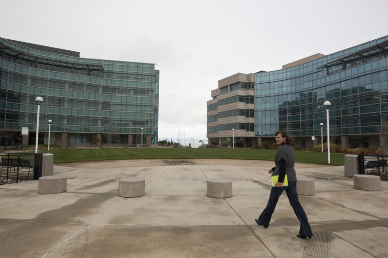A woman walks at the Genentech headquarters in South San Francisco, California, U.S., on Monday, Dec. 21, 2009.