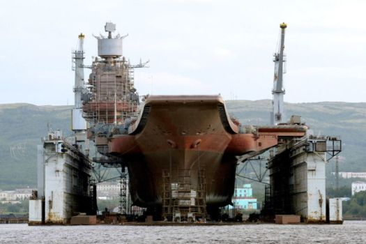 MURMANSK, RUSSIA - Russian aircraft carrier <em>Admiral Kuznetsov</em> at the PD-50 floating dry dock of Shipyard 82.