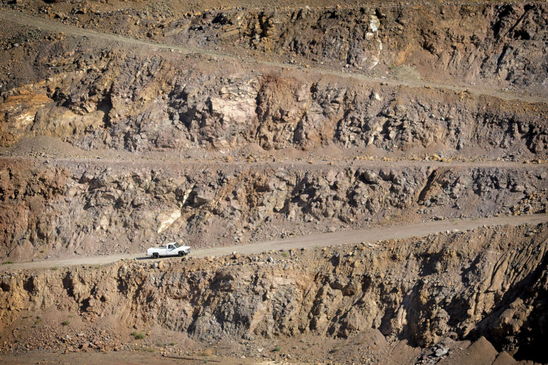 truck driving out of rare earth minerals mine