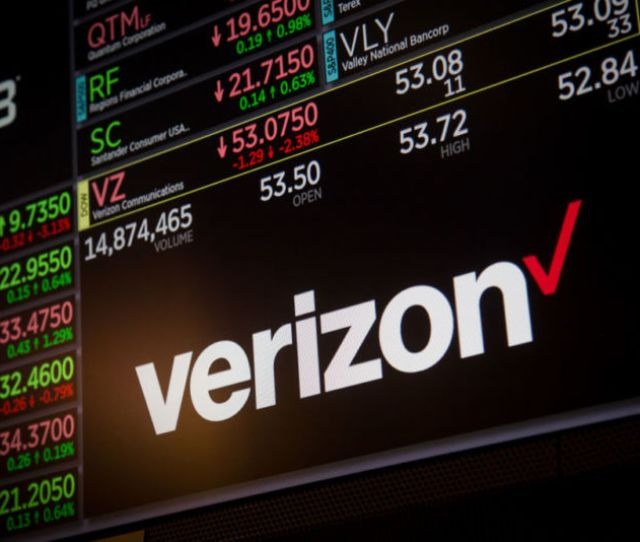 A Verizon Logo Displayed Along With Stock Prices At The New York Stock Exchange