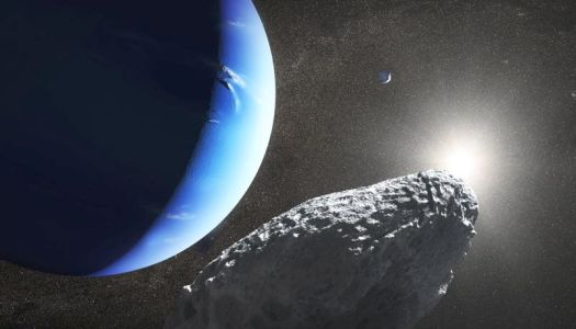 Image of a small, rocky body with Neptune in the background.