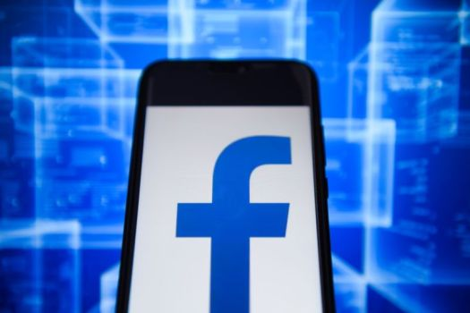 Facebook logo on a phone.