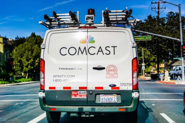 The back of a Comcast van driving along a street in Sunnyvale, California.